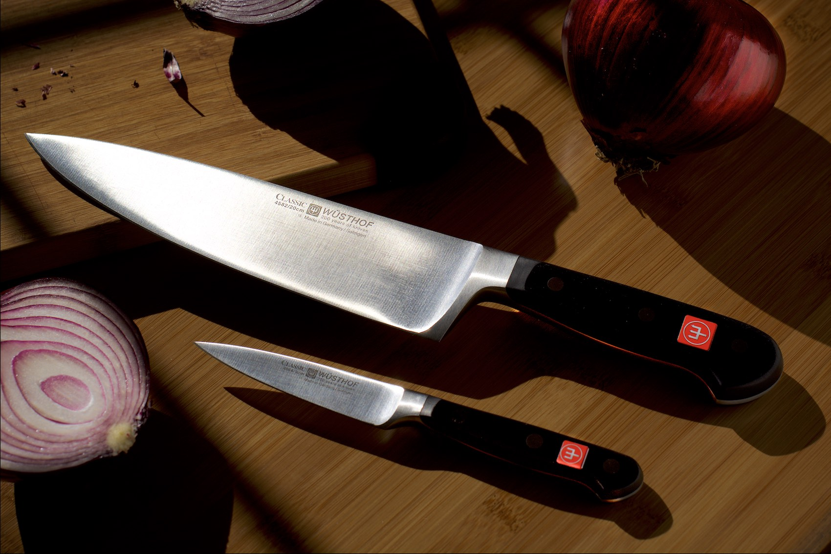 wusthof kitchen knives sliced onion cutting board food